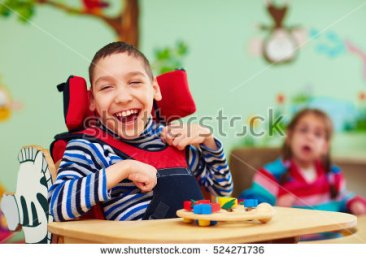 stock-photo-cheerful-boy-with-disability-at-rehabilitation-center-for-kids-with-special-needs-524271736.jpg