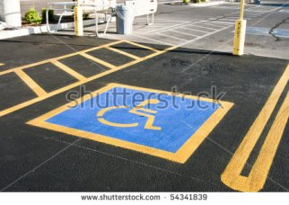 stock-photo-parking-space-reserved-for-handicapped-shoppers-in-a-retail-parking-lot-54341839.jpg